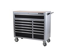 Tool trolley in robust double-wall steel construction. The drawers pull out fully and have sturdy, 46 mm ball bearing runners. The large top drawer has double runners. To avoid the risk of the trolley tipping forward under the weight of the tools, only one drawer can be opened at a time. All drawers are locked with a central locking system. All drawers also have transport locking mode when closed, ensuring that the cabinet can be moved without the drawers sliding out. Large, ball bearing (PU) wheels, two of which with braking function, 127 x 50 mm. Wooden panel for the work surface and thinner mats for all drawers. All drawers are endurance tested at a 40 kg load for 50,000 cycles. The trolley is endurance tested at a 300 kg load on a rolling shaker for 20 km.